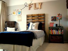 10 Awesome Boy's Bedroom Ideas...palette headboard for Tommy's bed.
