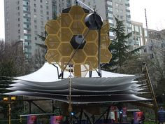 The James Webb Space Telescope , previously known as Next Generation Space Telescope , is a flagship-class space observatory under construction and scheduled to launch in October 2018. The JWST will offer unprecedented resolution and sensitivity from long-wavelength visible light, through near-infrared to the mid-infrared, and is a successor instrument to the Hubble Space Telescope and the Spitzer Space Telescope. The telescope features a segmented 6.5-meter diameter primary mirror and will…