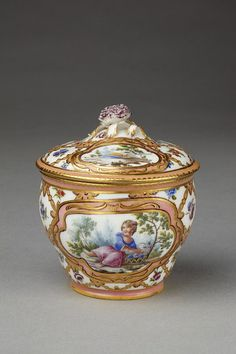 Pot a sucre Hebert   Sevres, ca. 1761. Sugar bowl and cover, sinuous sided, soft-paste porcelain, decorated with figures of children painted in enamels and gilt on a white and pink trellis ground. Lid with floral knop.