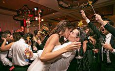 An amazing New Year's Eve wedding kiss! Photo by Joy Marie Studios.