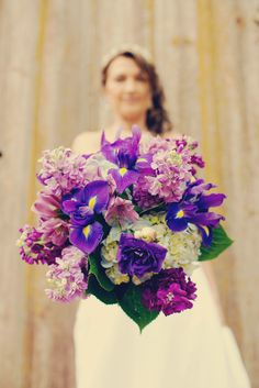 Beautiful bright bouquet - perfect for a #summerwedding! Photo by Ashley Y.