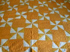 Vintage 1930's feed sack handmade quilt.  Cheddar pinwheels.