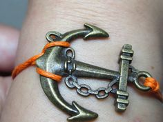 Anchor-antique brass anchor bracelet,small anchor  red wax cord bracelet. $1.99, via Etsy.