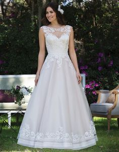 Sincerity wedding dress style 3935F Sand/Ivory/Nude Size 10Look romantic in this tulle and satin ball gown with an illusion Sabrina neckline, cotton lace appliques, banded trim, and illusion back that is completed with a chapel length train. Tea length version available as 3935.