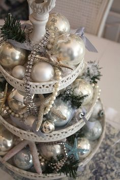 a beachy christmas centerpiece. make tiers from dollar tree stuff, spray paint blue beachy color and fill with mixed match ornaments of same family of color - House Decorators Collection Shabby Chic Christmas, Beach Christmas, Coastal Christmas, Silver Christmas, Noel Christmas, Vintage Christmas, Christmas Crafts, Beautiful Christmas, Christmas Ornaments