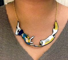 "Laura Li (a.k.a. ""Doppledew"") has created an awesome collection of handmade necklaces based on characters from the popular animated television show Adventure Time. The Jake, Lady Rainicorn, Cake an..."