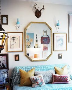 love the layout of art on the wall + colors