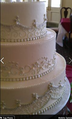 Ambrosia Bakery -- Each tier with scroll work of middle tier, but with the ivory pearl coloring