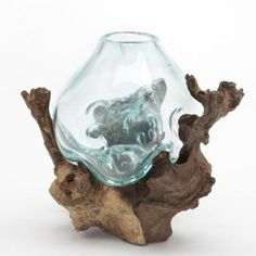 This one of a kind and totally unique piece began with a piece of a wood root and then a skilled artisan, who has a love and an eye for the art of glass blow...