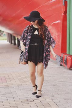 26 Ways to Style a Kimono for Spring - cute black + pink floral chiffon kimono  styled with a floppy hat, black romper, and pointy black ankle strap flats