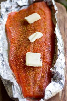This delicious and simple grilled lemon-pepper salmon recipe is easy, delicious, and something you're going to want to make over and over. Tilapia Recipes, Baked Salmon Recipes, Traeger Smoked Salmon, Salmon Fish Tacos, Traeger Recipes, Smoker Recipes, Lemon Pepper Salmon, Caramelized Bacon, Grilled Salmon