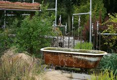 Love recycled materials, bathtub & pipes  Unusual water feature by jo-h, via Flickr