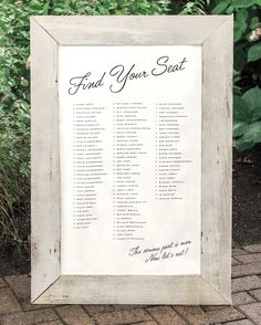 The bride's father crafted this handmade seating chart from wood salvaged from his North Carolina farm. The simple and chic addition included a list of guests' names and their table number.