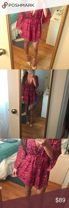 Show Me Your Mumu Romper Snake print Romper in fuscia pink and dark purple. Top is a low v, features a hook and eye and also a draw string to adjust waist. Shorts are flowy and lined. Runs a little big. Show Me Your MuMu Pants Jumpsuits & Rompers