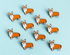 Pembroke Welsh Corgi Enamel Lapel Pin - Button This little pup wants to be your friend. These little corgi pins are the perfect gift and would look good on your hat, jacket, sweater, purse, shirt, or whatever. Wearing this pin will show the world how much you love Corgis! He was created from my original illustration and measures 1.25 wide. There are two pin backs on the back of this pup to keep him from spinning upside down. The pins are secured with rubber backs. Youll find The Paper…