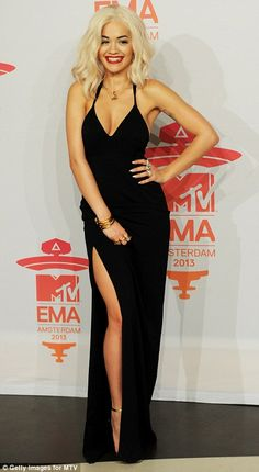Rita Ora. Now I'm loving dress. Very sexy! The hair, not so much...