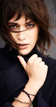 """Lizzy Caplan, Actress: Cloverfield. Actress Elizabeth Anne """"Lizzy"""" Caplan was born in Los Angeles, California, to Barbara (Bragman), a political aide, and Richard Caplan, a lawyer. She has two older siblings, Julie and Benjamin, and was raised in a Jewish household. Her mother was a cousin of publicist Howard Bragman. Caplan was educated at Alexander Hamilton High School, where she showed an interest in acting and was cast in ..."""