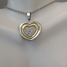 Crystal Heart Pendant Great gift idea. Made of stainless steel which does not tarnish or fade and crystals. Two tone of silver and gold. Comes on a 20 in chain.Price is my lowest Jewelry