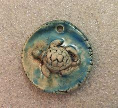 By Sheri Mallery,   Sea Turtle in muddy blue waters handmade ceramic by SlinginMud