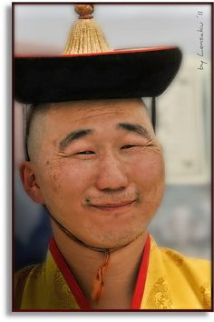 A Mongolian priest smiled for the photographer