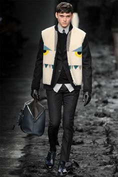 Fendi presented its Fall/Winter 2014 collection during Milan Fashion Week, featuring luxurious materials and sleek silhouettes.