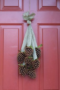 pine cones on ribbon....i like this better than a wreath.  If we could find some pinecones this would be super cheap!