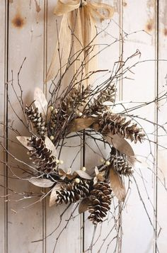 winter/autumn wreath ... from Cabin & Cottage ... pine cones ... big dry leaves ... skinny branches ...