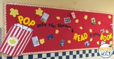 Movie Themed Bulletin Boards and Displays! This one, Pop into the library and read a good book, is a popcorn themed bulletin board that fits our movie theme perfectly!