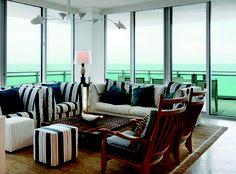 The corner perch of the living room in this oceanfront apartment in Bal Harbour, Florida has the feel of a sleek, ocean liner. Frank de Biasi, designer