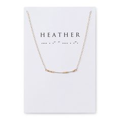 Keep a hidden message close to your heart with this necklace, featuring a morse code of gold and silver.