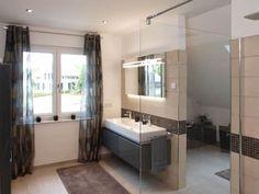 Badezimmer im Musterhaus Bad Vilber: moderne Badezimmer von SCHWABENHAUS GmbH & Co. KG