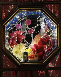 Harvey_Nichols_Kilian_Window. Mini lights, asian flowers, octagon