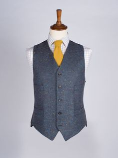 Donegal Tweed Waistcoat in Ocean - We've remixed our Donegal Tweed this year to include a deep earthy brown herringbone as a subtle background. Woven in Donegal from 100% pure wool and flecked with berry red and gold, this waistcoat would be an elegant addition to your wardrobe.