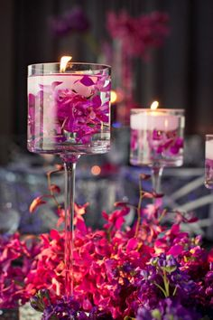 DIY Wedding Flower Arrangements: There is something magical about floating floral arrangements that are tall. These centerpieces are definitely attention grabbing!