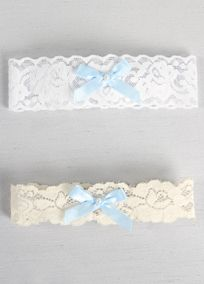 """Add something blue to your day with this simple and sweet lace garter adorned with a blue satin bow and faux pearl bead. This delicate garter is a beautiful accessory and the perfect """"Something Blue"""" to add to your day."""