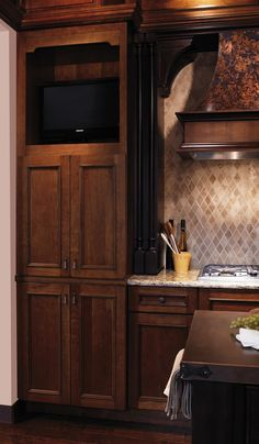 Use your tall cabinet to hold a TV! You can cook and clean while watching the daily news!
