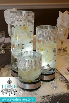 Black, White and Silver Wedding Decor, cylinder centerpieces with submerged orchid and led lights, winter wonderland wedding decor, cylinder vase centerpieces with ribbon and artificial snow wedding decoration Silver Wedding Decorations, Wedding Centerpieces, Wedding Tables, Silver Weddings, Wedding Ideas, Romantic Weddings, 25th Wedding Anniversary, Anniversary Parties, Cylinder Vase Centerpieces