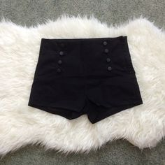 NWOT high waisted black denim shorts NWOT black denim shorts. High waisted. Faux buttons. Side zipped. Size 31. Very stretchy. Cotton, polyester, spandex. Faux back pockets.  Fits size 8-10. Forever 21 Shorts