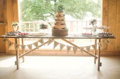 Naked wedding cake and dessert table. Photo by Dot & Anchor Photography, cake and desserts by Sweet Art Bakery, floral by Holly Viles Design, taken at The Venue at Waterstone.