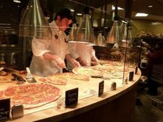 Whole Foods Pizza - a favorite spot for a quick slice for lunch - heated and ready to go in 5 min or less - cheap too!