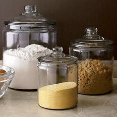 large glass jars with lids.my mom has these exact! Love them