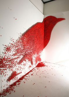 Red bird made out of push pins!