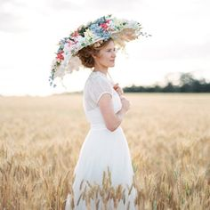 A vintage prairie themed wedding inspiration board with a must-see flower covered parasol. (photography: Feather and Stone)