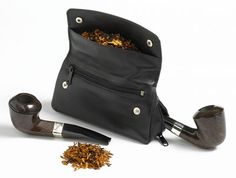 Pipe tobacco pouch, holds his tobacco, pipe, & pipe tamper....maybe get his initials on it.