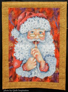 Santa's Secret, hand painted, by Ruby Koch. Inspired by a class with Patt Blair. Photo by Quilt Inspiration.