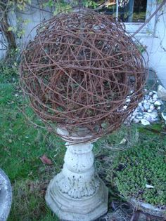 Old rusty found farm fencing reclaimed as rustic   barb wire ball sculptural orb garden ornament yard art.