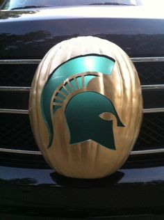 """Michigan State University Sparty Pumpkin. MOLON LABE.jpg Trim the pattern, leaving a 1/2"""" border around the design. Tape the pattern to your pumpkin.  Make pattern fit smoothly with small folds at black slash lines. Tape folds in place. Use the Detail Saw.  Hold pumpkin in your lap. Hold the saw like a pencil and saw steadily with a continuous up-and-down motion.  Saw at a 90° angle to the pumpkin. Use gentle pressure. These saws are breakable if used incorrectly."""