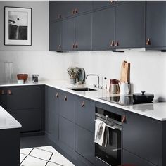 A dark grey and marble kitchen ♡
