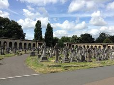 View of the numerous tombs in the central roundrel of Brompton Cemetery, London, England, near the Chapel close to the south end.  Below the colonnades are catacombs which were originally conceived as a cheaper alternative burial to having a plot in the grounds of the cemetery. Unfortunately, the catacombs were not a success and only about 500 of the many thousands of places in them were sold.