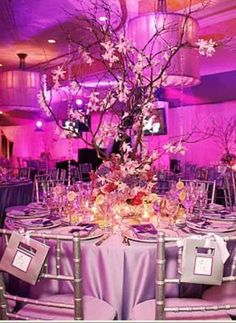 See MORE @ SuperWeddings.com    I am developing an obsession with branch wedding centerpieces! I also love this wedding decor with shades of purple and red. And the fabric on those table covers and chair covers is to LIVE for! Cool the way they tie the menu cards to the backs of the chairs with pretty ribbon.